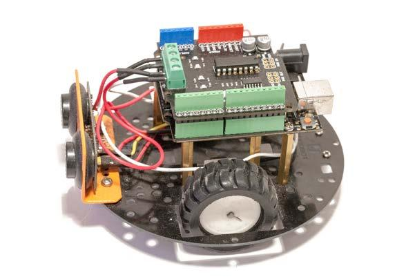Then, you need to attach the different Arduino boards and shields to the robot.