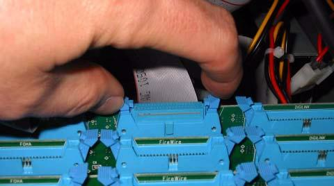 13 If you are connecting a second HDx card, attach its ribbon cable from the ribbon connector on the HDx card to the connector labeled FireWire on the second Mix Engine card from the back.
