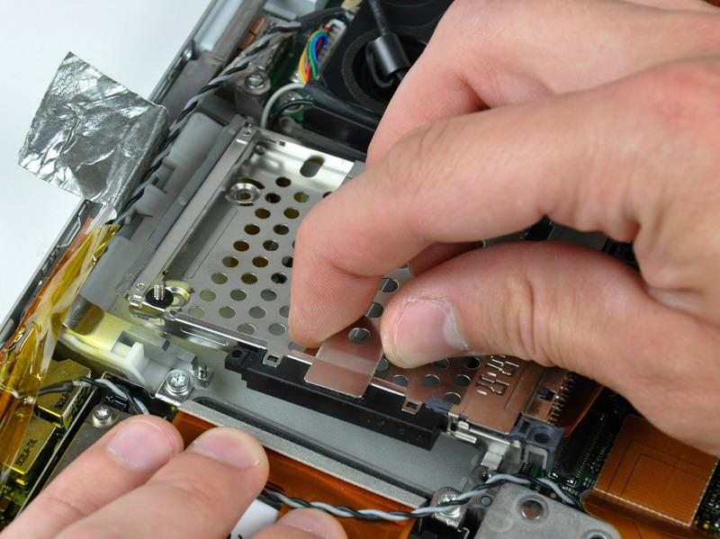 Step 21 When reinstalling your PC card cage, be