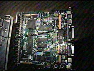 . Here is the logic board s placement inside the Macintosh SE. you slide it up a bit and pull it towards you.