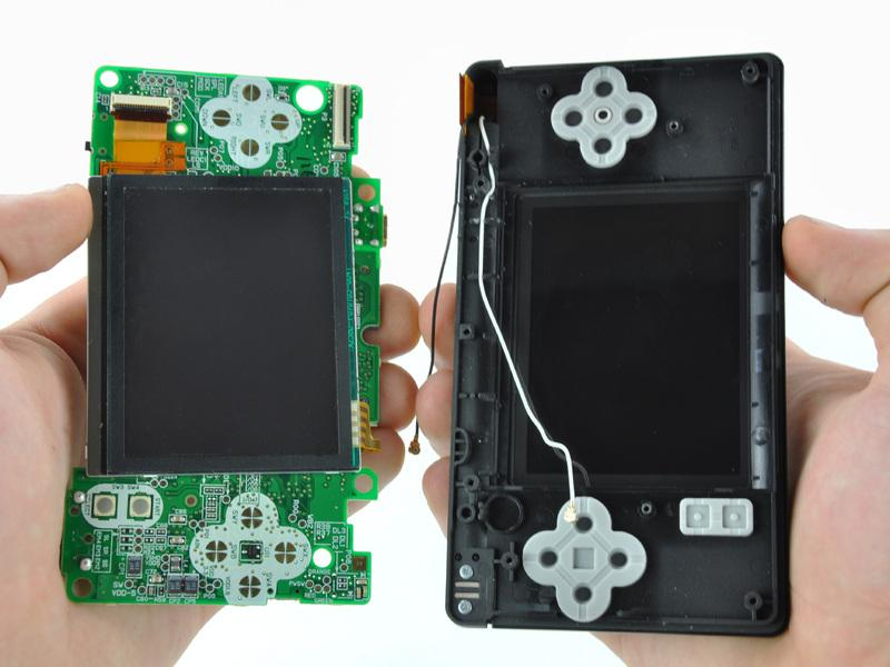 Pull the motherboard away from the DS Lite to separate the upper LCD ribbon cable from its socket on the motherboard.