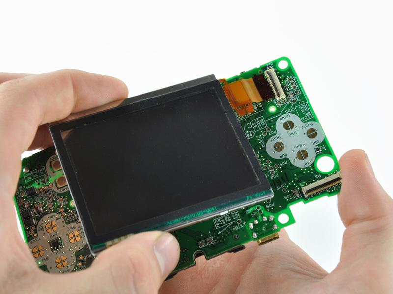 Pull the lower LCD assembly straight away to separate the lower LCD ribbon cable from its socket on the motherboard.