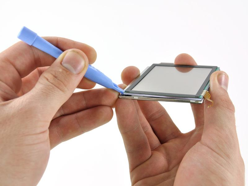 Step 18 Touchscreen Insert a plastic opening tool between the