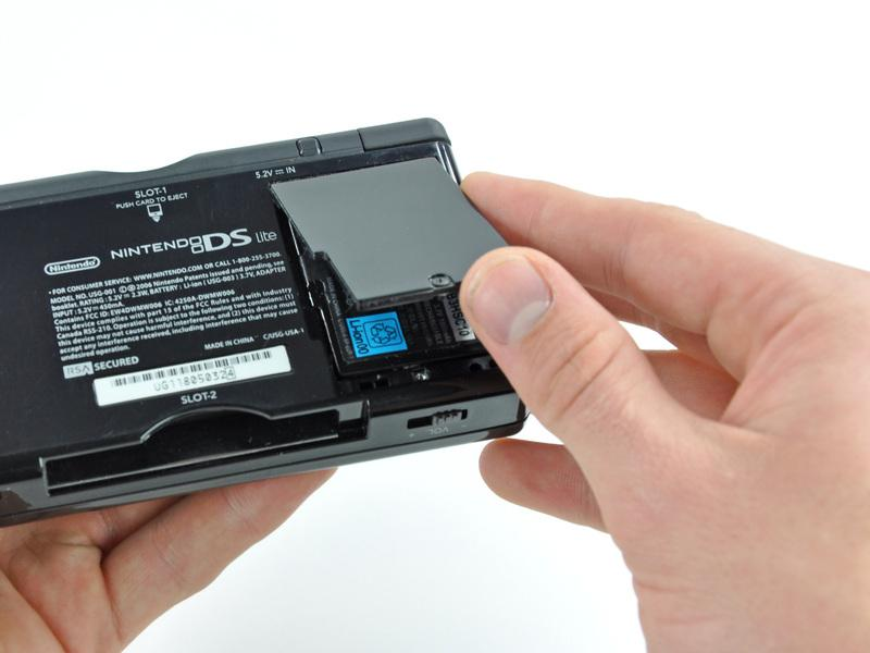 Pry the battery cover upward with a spudger or fingernail, and lift out of