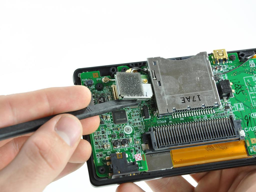 Nintendo DS Lite Touchscreen Replacement Step 10 Use the flat edge of a spudger to separate the right edge of