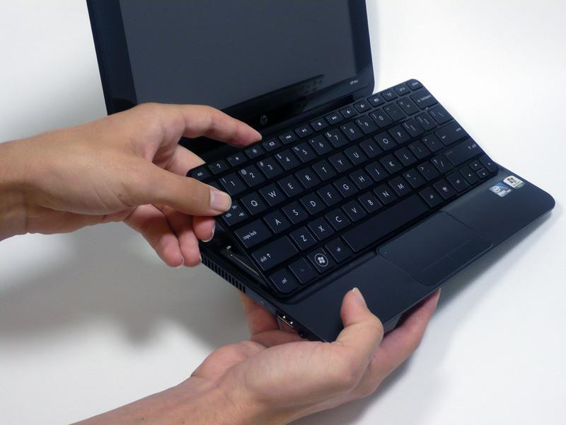 using a plastic opening tool. Do not yank the keyboard out.