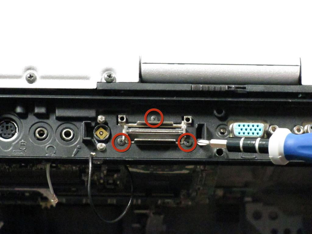 screws surrounding the serial port.