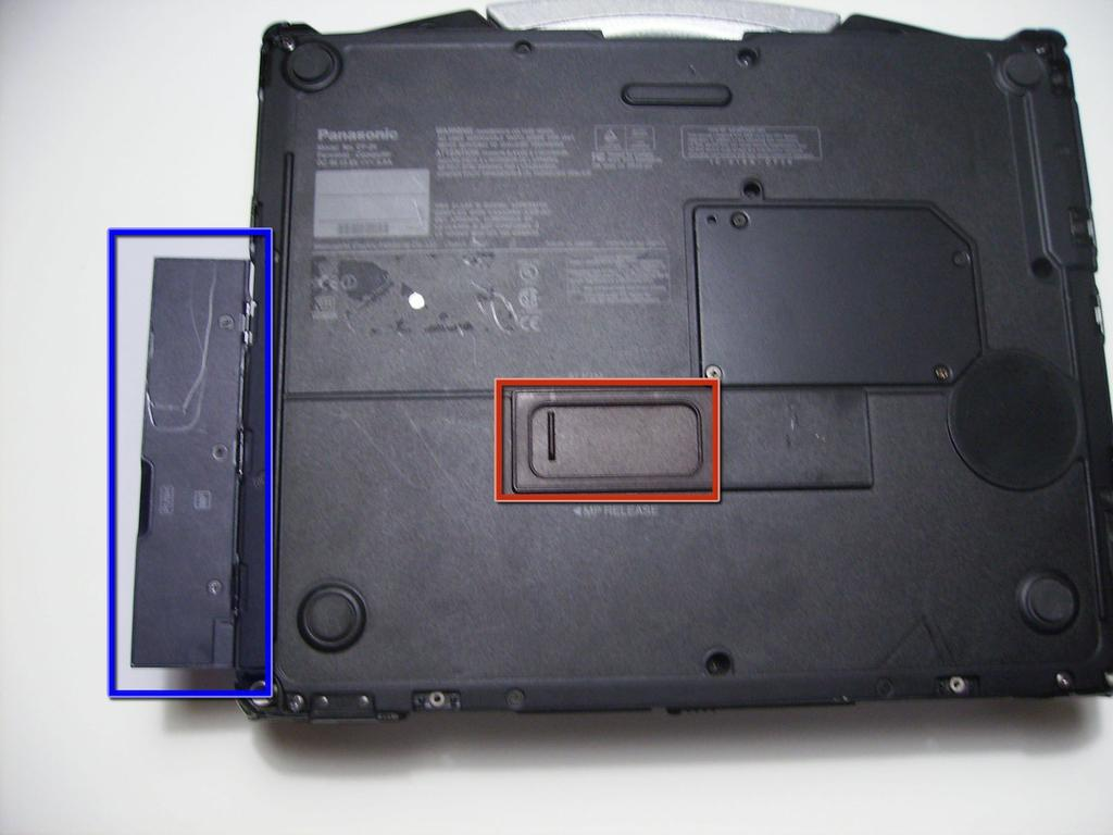 Step 5 Optical Drive Flip the device upside down with the handle facing away