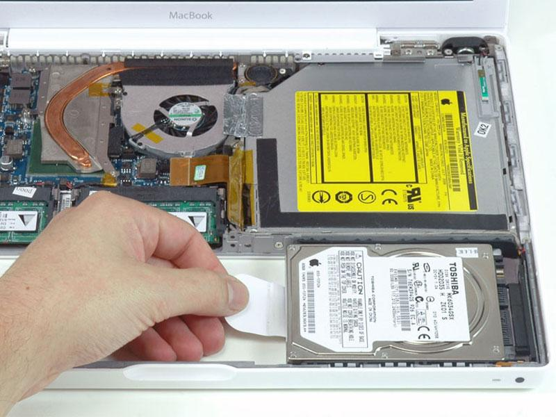 Step 13 Optical Drive Grasp the white plastic tab attached to the hard drive and pull it