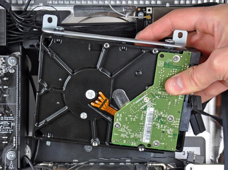 case. Lift the hard drive off its two lower positioning
