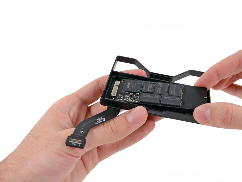 Step 15 Carefully pull the SSD straight out of its socket on the SSD tray. Step 16 SSD SSD remains.