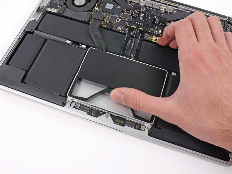 Step 11 Use your thumb or finger to bend the plastic spring bar on the SSD tray, freeing the two