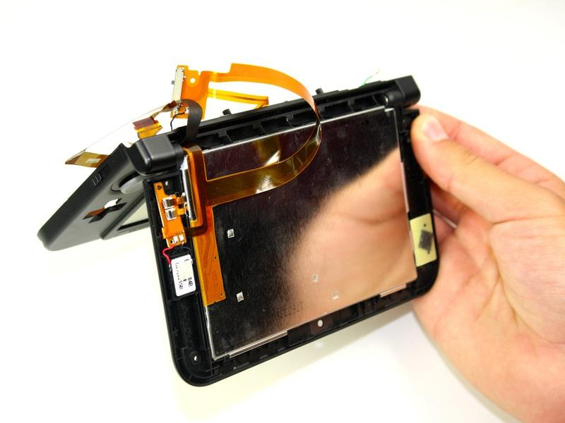 Step 29 Open the hinge and carefully pop off the Upper LCD using your fingers. Gently remove the ribbon from the hinge.