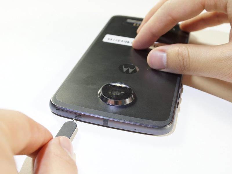 Step 2 Remove the sim card housing by pressing firmly in