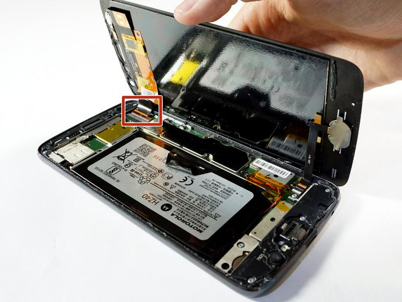 Step 7 Identify ribbon connector at the top right of the phone.