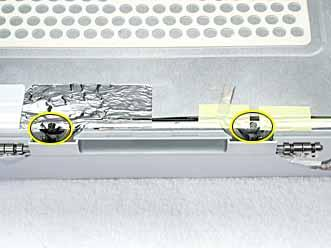 5. Peel up the tape if it covers the two screws at the clutch.