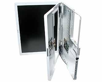 7. Place the computer on its side, and with most of the top case loosened, tilt the top case away from the computer latch.