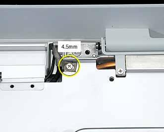 Replacement Note: The longest screw at the top shield secures the LVDS cable to the shield and frame. 2.