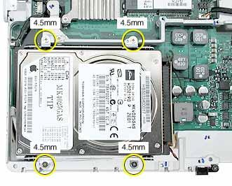 4. Remove the four identical screws at the hard drive bracket. 5.