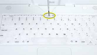 Procedure 1. Raise the display so you can access the keyboard. 2. Make sure the keyboard locking screw, located in the small plastic tab next to the Num Lock key, is not in the locked position.