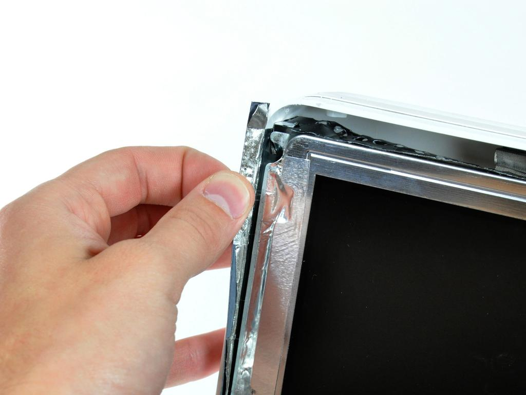 Step 11 Peel back the aluminum EMI tape from the two vertical edges of the display.