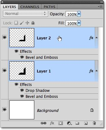 Step 16: Merge The Two Shapes Onto A New Layer With Layer 1 selected, hold down your Ctrl (Win) / Command (Mac) key and click on Layer 2 in the Layers panel.