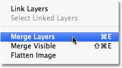 With both layers selected, go up to the Layer menu and choose Merge Layers, or press Ctrl+E (Win) /Command+E (Mac) for the keyboard shortcut: Go to Layer > Merge Layers.