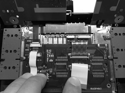 Route the factory LCD ribbon cable through the slot of the