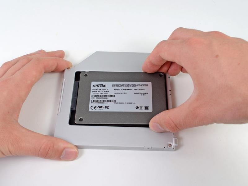 Gently place the hard drive into the enclosure's hard