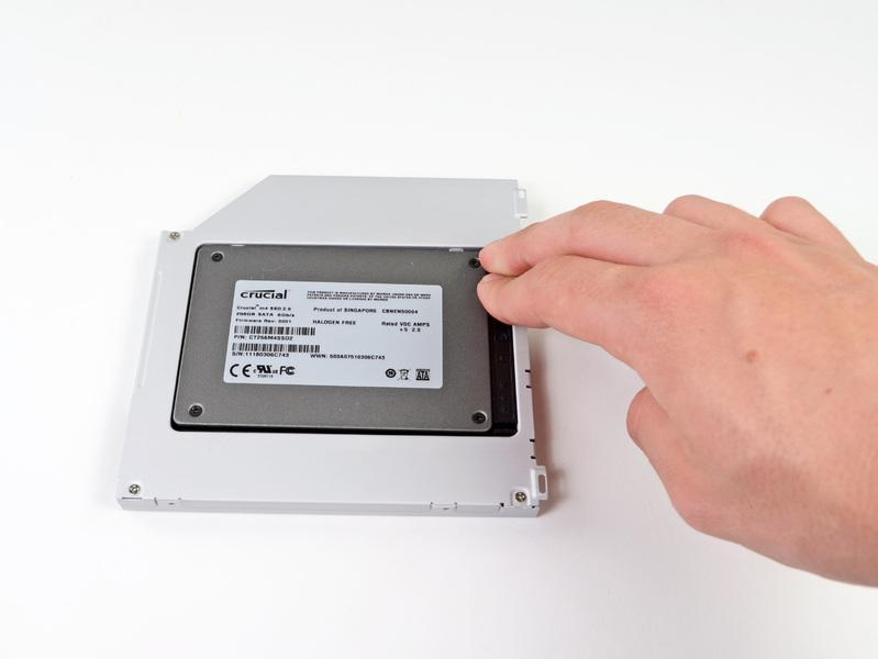 positioner while holding the hard drive against the