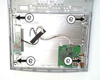 (the aluminium speakers panel is held by two plastic pins and two plastic tabs.