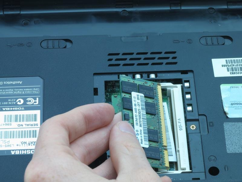 Repeat step 9 to remove the other RAM card