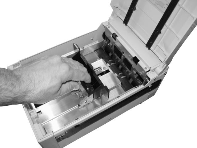 If you pull the cash plate back all the way it will lock at the front of the cassette. Push the green lever on the cash tray to release.