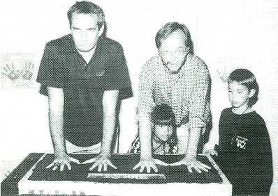 www.americanradiohistory.com Dan's Hands. Steely Dan members Donald Fagen, left, and Walter Becker imprint their hands for for the 50th induction of Hollywood's Rock Walk.