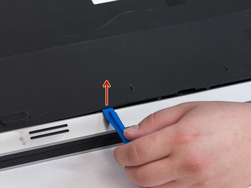 Pull battery upwards by the tab to remove from the laptop.