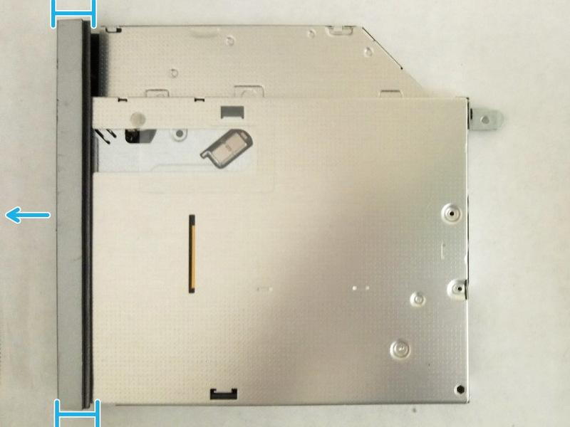 Carefully pull the optical-drive bezel and