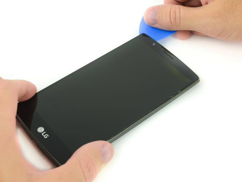 There is a very thin strip of adhesive that holds the screen to the