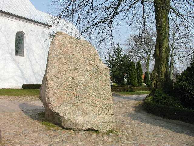 and the real rune stone Located in Jelling, Denmark, erected by King Harald Blåtand in