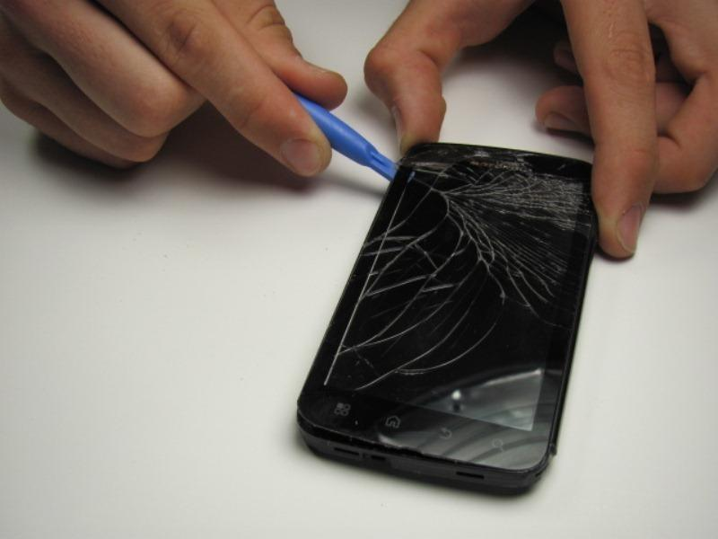 phone. As you work, the adhesive may cool and harden.
