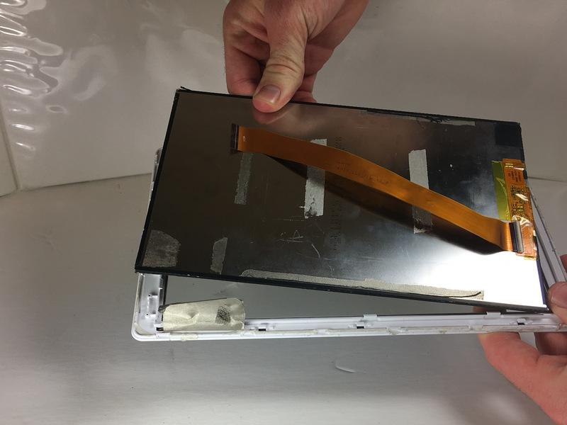 Insert the plastic opening tool between the front case and