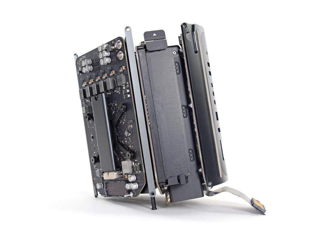 Step 17 Power Supply Assembly Flip the Mac Pro back over and