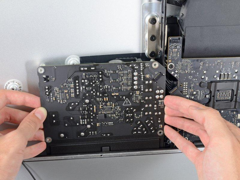 3 mm Torx screws Step 37 Do not attempt to remove the power supply from the case; it is still attached to the
