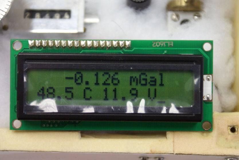 LCD DISPLAY This 2-line extended temperature version LCD display is installed on the black gravity meter lid. The display is specified to work in ambient temperatures of -20 C to +50 C.