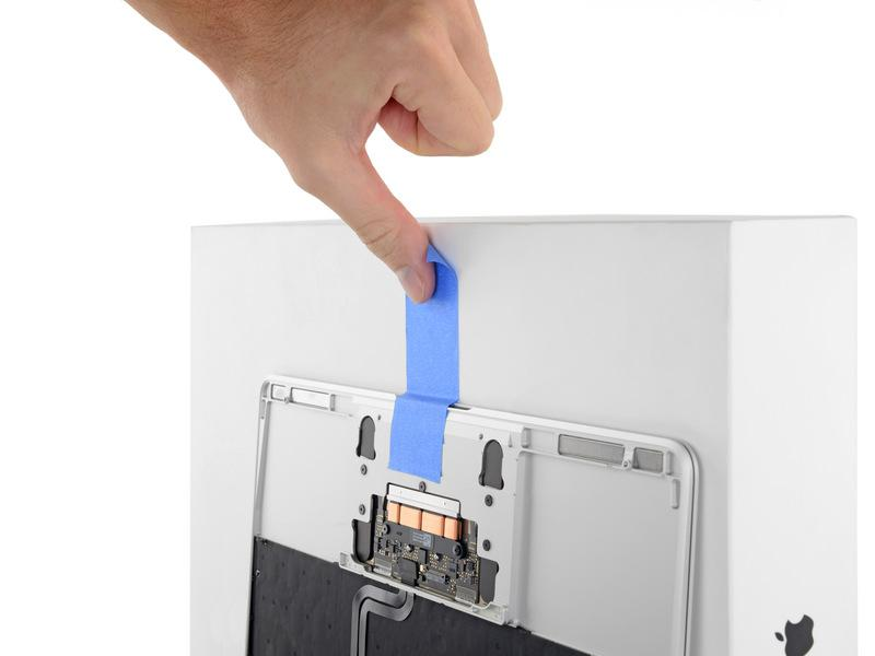 hold it. Add a piece of tape near the track pad to secure the upper case and prevent accidental movement.