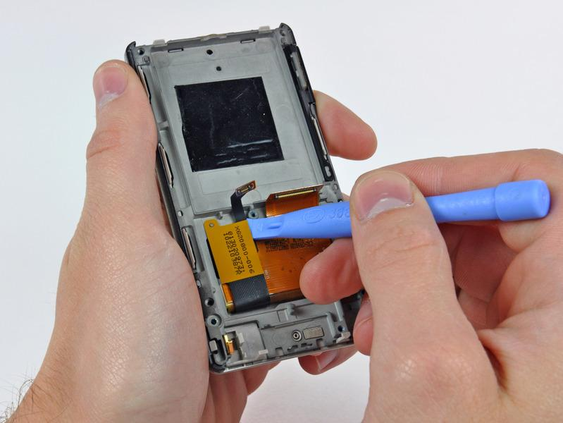 Step 15 Use a Zune opening tool to peel the