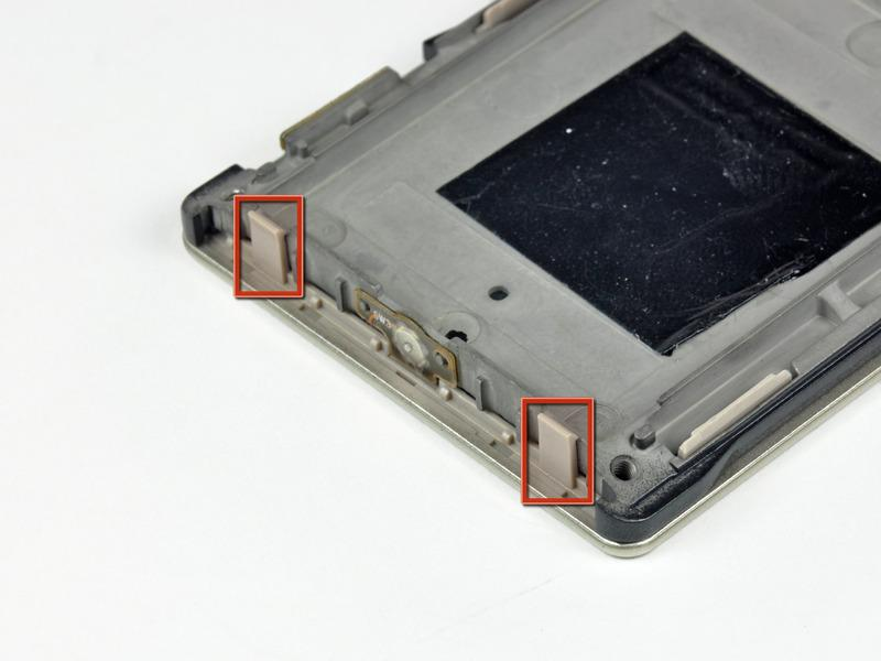 The five plastic clips along the side of the Zune lock onto small aluminum tabs cast into the inner chassis.