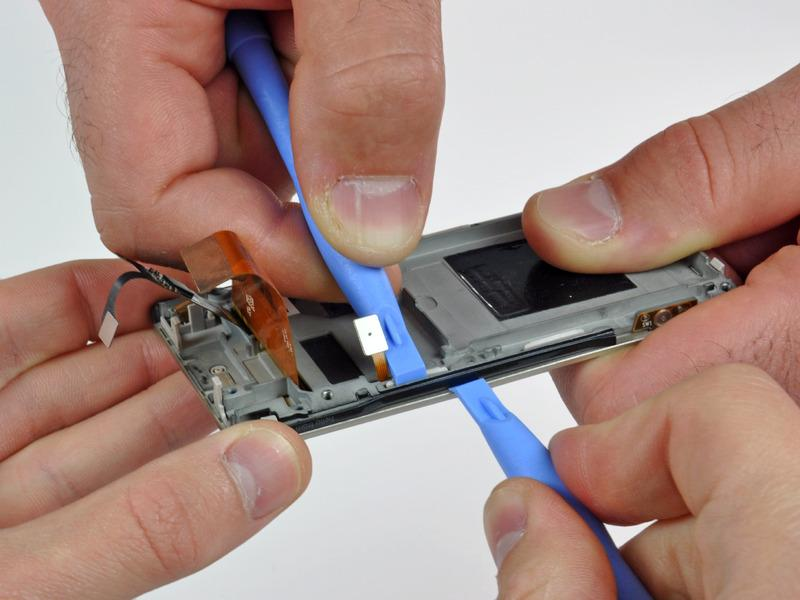 tool to push the plastic clip near the control cable connector toward the inside of the Zune.