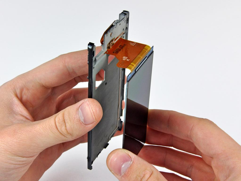 Step 22 Carefully de-route the display data cable through the inner chassis and remove the OLED display.