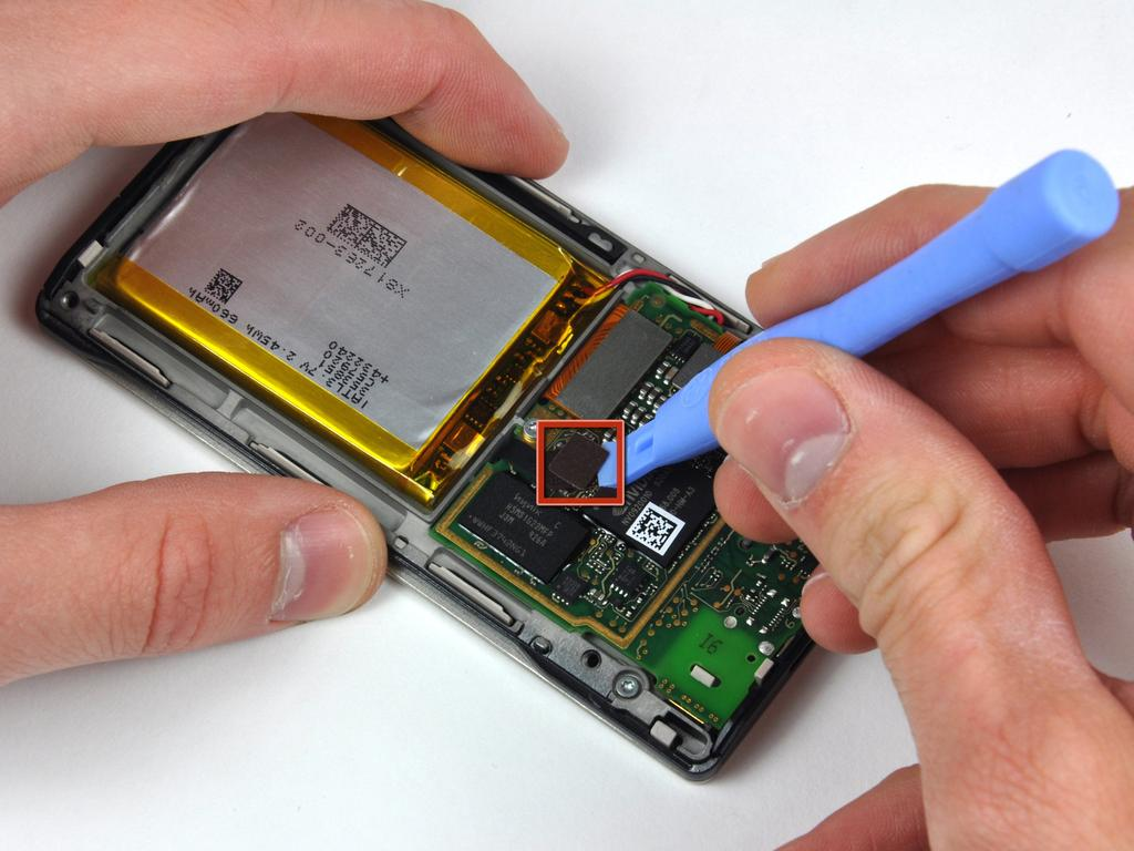 Step 5 Battery & Logic Board Use a Zune opening tool to pry the