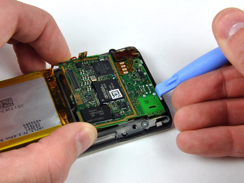 Step 10 Use a Zune opening tool to push the small plastic clip securing the logic board near its lower